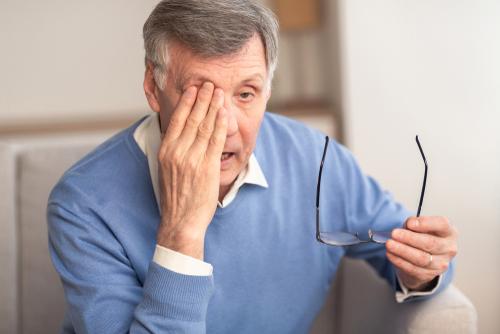 Man rubbing his eye